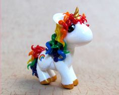 Rainbow Unicorn by DragonsAndBeasties on flickr - Just adorable I say!