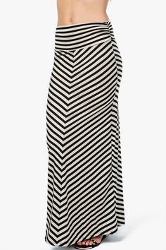 A jersey maxi skirt with a thin chevron striped body. Pair it with a basic tank and sandals this summer! Foldover elastic waist.