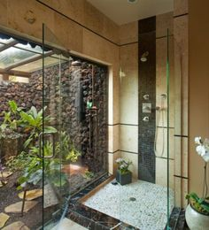indoor/outdoor showers - tropical bathroom by James Patrick Walters