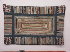 291: HOOKED RUG. Polychrome with oval center : Lot 291