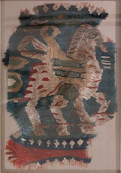 9th c. Egyptian wool and linen tapestry-woven fragment (10 1/2 x 7 1/4 in.) - Met Museum 1974.113.7