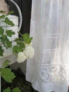 Embroidered white curtains.