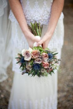 I love this bouquet, the combination of delicate roses and blue thistles is inspired #roses #bouquet
