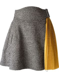 Great pop of color as well as a mix of textures and fabric. Carven pleated panel skater skirt.