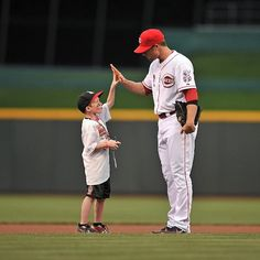 Zack Cozart makes a new friend during the on field ceremonies.
