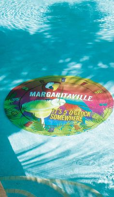 A perfect addition to a tropical-inspired pool, this vibrantly colored Margaritaville Pool Mat is created using a heavy vinyl that is easily held in place by gravity and water pressure. | Margaritaville by Frontgate