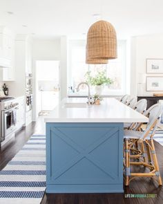 Cheap Home Decor Coastal inspired kitchen with basket light pendants white countertops blue island and Serena Lily bar stools.Cheap Home Decor Coastal inspired kitchen with basket light pendants white countertops blue island and Serena Lily bar stools. Cheap Decor, Cheap Home Decor, White Countertops, Western Home Decor, Kitchen Decor, Coastal Kitchen Decor, Blue Kitchen Island, Home Decor, Coastal Kitchen