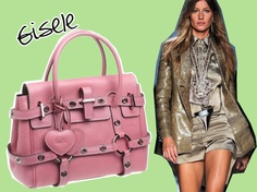 A bolsa Gisele da Luella com tags em formato de coração parece ser feminina demais para o estilo da top. Mas o modelo acabou se tornando favorito depois de ter sido lançado em 2002 como parte de uma colaboração com a Mulberry, ajudando a recuperar da falência a agora extinta Luella.