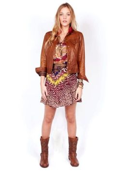 Gorgeous tan leather jacket and eclectic little frock. Cute combat boots too. Bendito Pie.