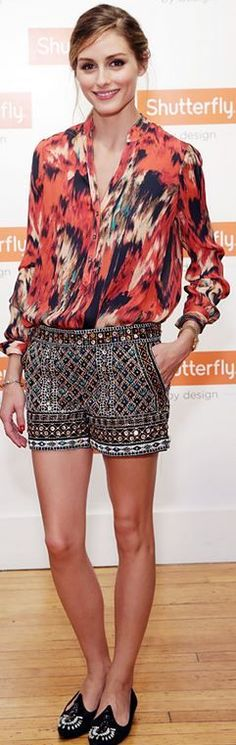 Olivia Palermo in embellished shorts and pink print shirt