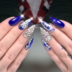 Glamorous set of deep shiny blue nails with lots of bling and silver transfer foil! Beautiful nails by Ugly Duckling Master Educator @amyduclosnails - ❄️☃️New Years Bling☃️❄️Ugly Duckling #72 Gel Polish  Ugly Duckling Nails page is dedicated to promoting quality, inspira