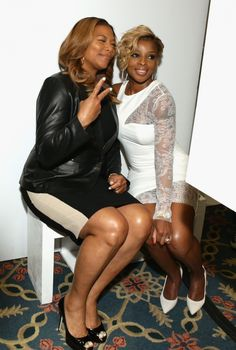 GRAMMY winners Queen Latifah and Mary J. Blige have fun at the photo booth at the 2014 Matrix Awards on April 28 in New York