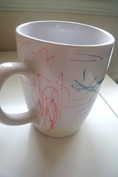 for the kids to make for christmas gifts // Sharpie Decorated Mugs DIY - making this for my son to give to his daddy .. hope it looks good