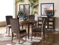 You'll fall in love at first sit! Achieve relaxed, elegant dining with the Beaumont round dining set.