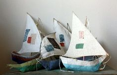 Holy Swallows and Amazons!  I luuurve these paper mache boats *heart heart heart*            There is a tutorial and pattern from Ann Wood at http://annwood.net/blog/2009/12/11/paper-mache-boat-pattern/