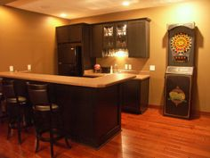Gotta have a wet bar. Love the large fridge too.