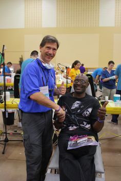 """James from Lake Geneva visited WDA's fifth Mission of Mercy to get his smile back. James was WDA MOM's 10,000th patient encounter. He was at MOM for 12 hours yesterday and says that even though it was a long process that it was worth every minute. Dr. Kenneth Geiger (Sheboygan) worked on Mr. 10,000 and helped fit a partial for James. """"I've got my smile ability back!"""""""