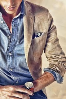 Light coloured jacket on denim shirt, like the detail of the blue coloured pocket square bringing the ensemble together.