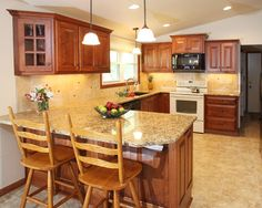 On pinterest granite countertops maple cabinets and cherry cabinets