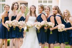 Navy bridesmaids dresses with mix matched styles.    Photography by Jodi Miller Photography.