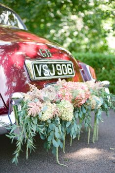 Vintage Car with Floral Garland | photography by http://www.emmawyatt.com/ Styled by Wedding Sparrow