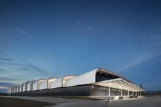 Image 1 of 70 from gallery of SP 21 / A. Photograph by Fernando Guerra Factory Architecture, Sheet Metal Fabrication, Roof Ceiling, Industrial Architecture, Factory Design, Ground Floor Plan, Ventilation System, Steel Buildings, Staircase Design