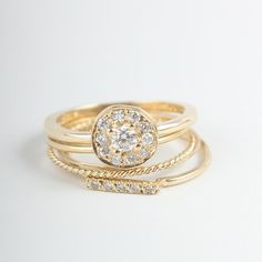 catbird-nyc: Cannot get enough of this golden stack!! Bottom to top: Dainty Stacking Pavé Ring, Twisted Stacker, Threadbare, Thin Band, Sab...