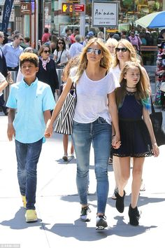 Model mother: Heidi Klum proved once again what a devoted mother she is as she spent the day with her four kids on Wednesday taking them to see the Broadway musical, School of Rock