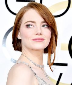 Emma Stone attends the 74th Annual Golden Globe Awards.