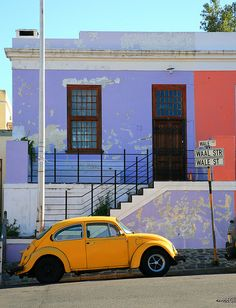 Colourful combinations in Cape Town's Bokaap district and an old VW Beetle 'tjorie' still in its original orange paintwork.  Bokaap #1, Cape Town by 1/8 sec, via Flickr