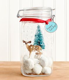 Skip the same-old tin and give cookies in a festive (airtight!) jar instead. Step 1: Use a fine-tipped brush to paint small white dots on the outside of a glass jar (1.6-quart Hermetic Storage Jar, $7;containerstore.com). Step 2: Fill bottom of jar with snowball cookies (for the recipe, click here). Place small plastic trinkets inside for a snow globe-inspired vignette. Step 3: Tie gift tag to jar with ribbon.