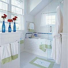 White Backdrop: The added extras in this crisp white subway-tiled bath are what make it worth a second look. The apple green accents on the towels and bathmat bring the whole look together and prove that style doesn't have to come at an extravagant cost.