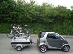 iframe Mercedes Smart, Smart Auto, Smart Fortwo, Motorcycle Camping, Camping Gear, Smart Car Body Kits, Small Electric Cars, Smart Car Accessories, Bike Cart