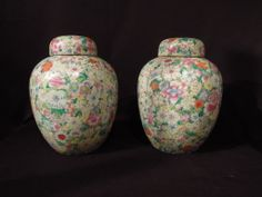 L1-106  13.5''h x 10'' diam.  Pair of covered Famille Rose Chinese porcelain jars.  19th century.