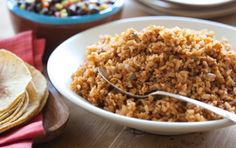 Baked Mexican Brown Rice | Whole Foods Market-- (use broth in place of water, omit salt). yum!