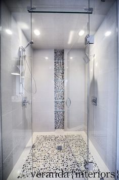 Pebble floor and back-splash, modern tile, frame-less glass door and panels, narrow dual shower. Shower Niche, Master Shower, Master Bathroom, Shower Bathroom, Beautiful Bathrooms, Modern Bathroom, Small Bathroom, Ikea Bathroom, White Bathroom