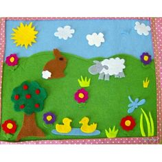 felt play mat - add ribbons on the side so it can be rolled up and tied shut