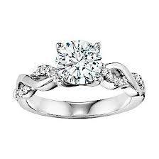 10 Engagement Rings Every Girl Dreams Of - 1. jThe Braided Pave Band This beautiful pave band is braided with a simple band, making it anything but ordinary.