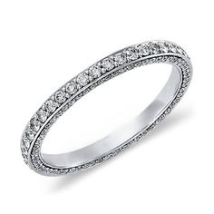 Delicate in essence, this diamond eternity ring in platinum showcases a full circle and three rows of  petite micropavé-set diamonds, beautiful as a wedding or anniversary ring.
