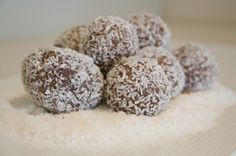 RUMBALLS  Rum Ball Recipe Ingredients 1 packet plain sweet biscuits  3 tblspns cocoa powder 1 cup desiccated coconut 1 can sweetened condensed milk 2-3 tblspns rum  1 cup extra coconuT Rum Ball Recipe Method crush biscuits, Add cocoa power, coconut, sweetened condensed milk and rum to crushed biscuits. Combine all ingredients well Take large teaspoons of mixture and roll into balls using your hands, then roll balls in extra coconut to coat.