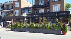 Instead of parking, section of street is used for restaurant seating, planters.