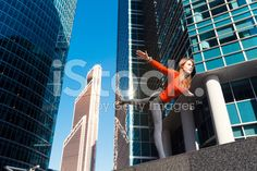Young girl doing yoga outdoors in city royalty-free stock photo