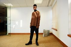 Inside the walls of an empty office, Haider Ackermann's Fall 15 menswear transmits confidence and composure.
