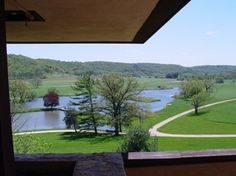 A view of the lake and fields from Taliesin bedroom terrace