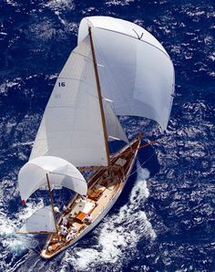 Under full sail on a sapphire blue sea