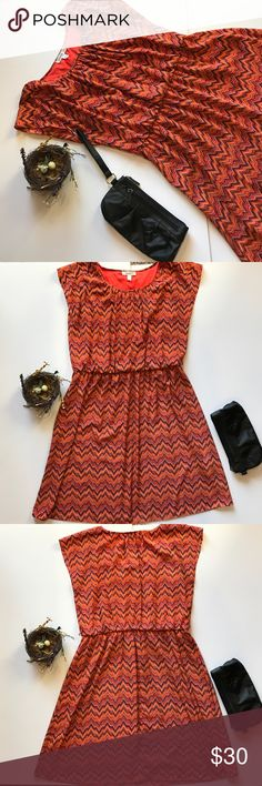 Size 16 Dress Barn small chevron sleeveless dress Sweet dress with tiny chevron print in orange, blue and navy. Elastic waist. 100% polyester. Machine wash cold. Bodice is lined. In EUC Worn twice. Wish I could still fit this because I ❤️ it! Dress Barn Dresses