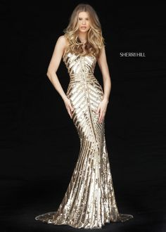 Command attention and demand applause when you enter the room in Sherri Hill 51206. This sparkling beaded evening gown is nothing short of AMAZING. This gown is fully beaded from top to bottom with an intricate sparkling bead pattern that runs vertical, horizontal, and diagonal lines around the body to perfectly accentuate  your body. var _currentScript = document.currentScript || null; (function () { var script = document.createElement('script'); script.type = 'te...