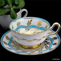 Vintage ROYAL CHELSEA Exotic Hand Painted Aqua Gold Footed Tea Cup & Saucer Set