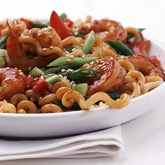 Stir-fried shrimp and vegetables and an Asian sauce make for a fun and quick pasta dinner.