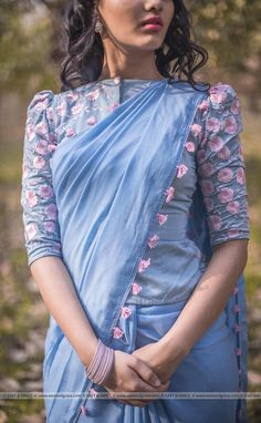 PRICE INR 9,999/- US$ 151.00 Click here https://www.eastandgrace.com/products/mimi-pure-silk-chiffon-saree Featuring the Mimi pure silk-chiffon embroidered sky blue saree with baby pink tassels along the edges. The blouse comes with baby pink floral embroidery along the sleeves and has thin leaf wreath embroidery and florets at the back. care@eastandgrace.com #eastandgrace